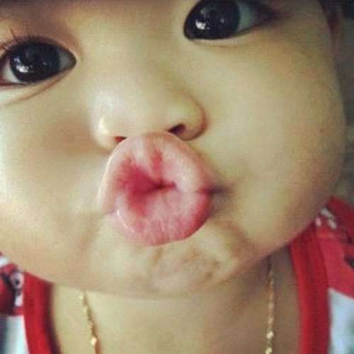 baby kissing because she loves parents who book doctors appointments